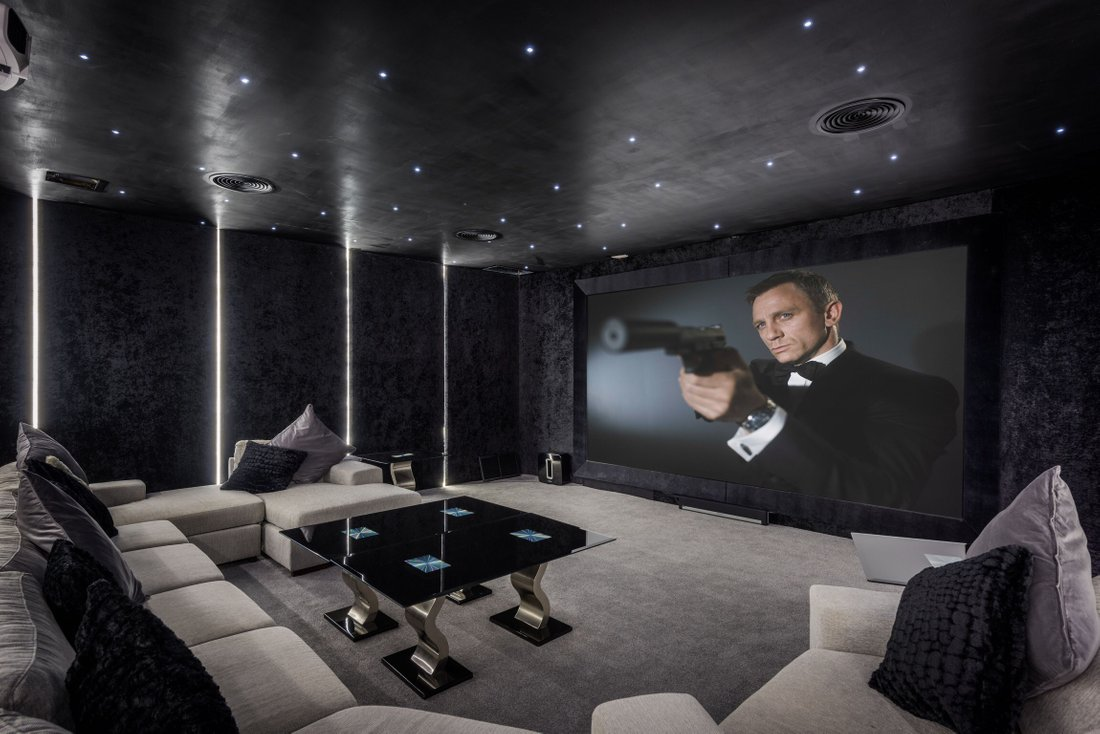 dark theme luxury home theater with fiber-optic star ceiling design